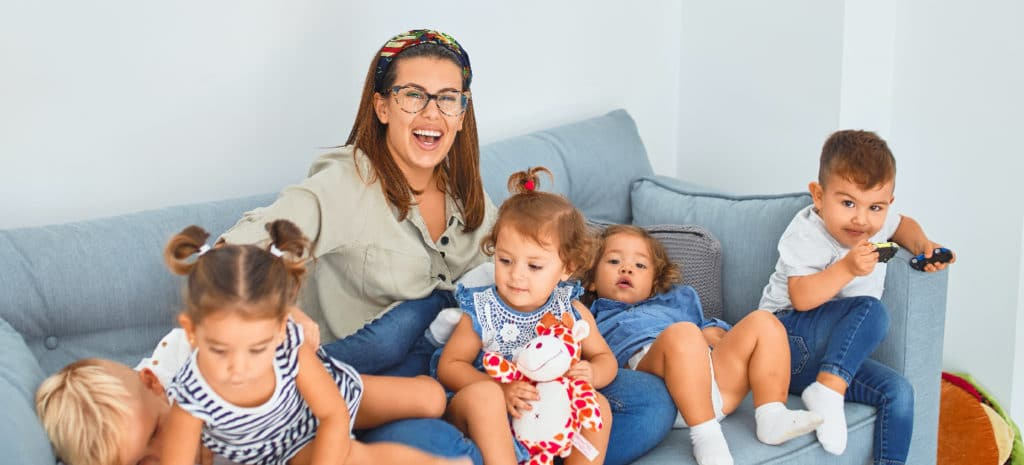 a mom and five kids on a couch | The couch is blue, which is probably important somehow.