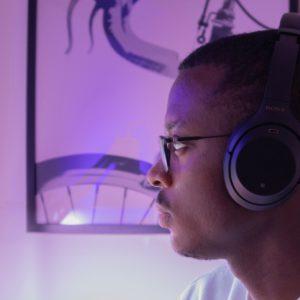 screen-lit man wearing headphones