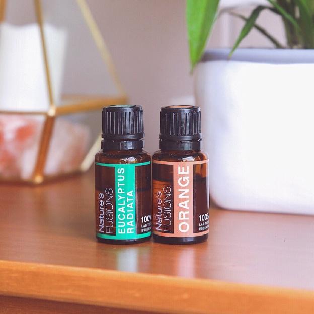 eucalyptus and orange oils on table