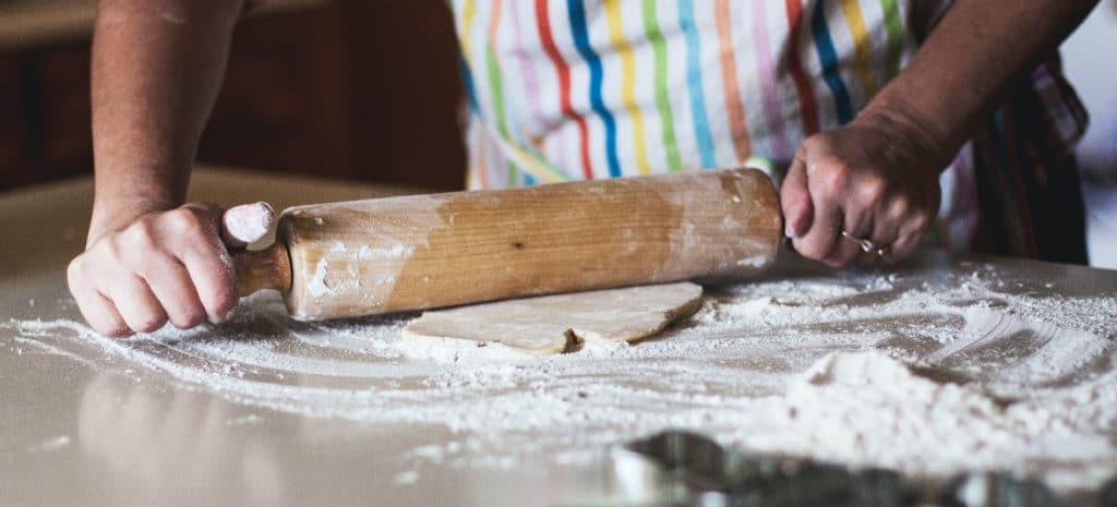 a person rolling bread dough