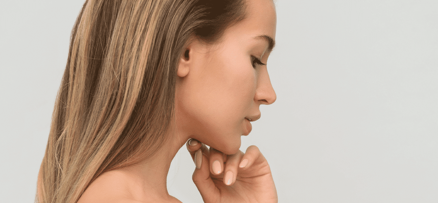 woman with hand under chin
