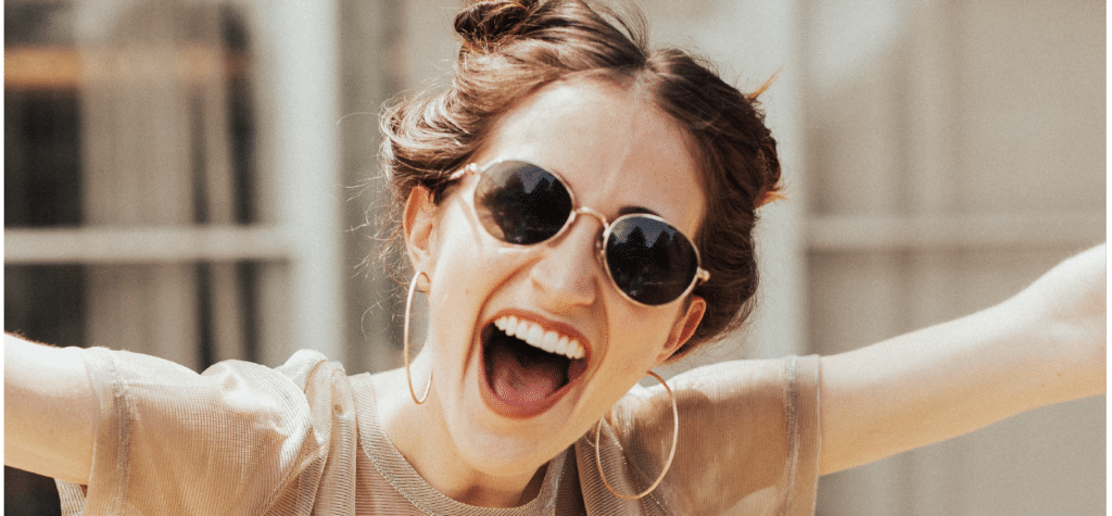 woman in sunglasses laughing