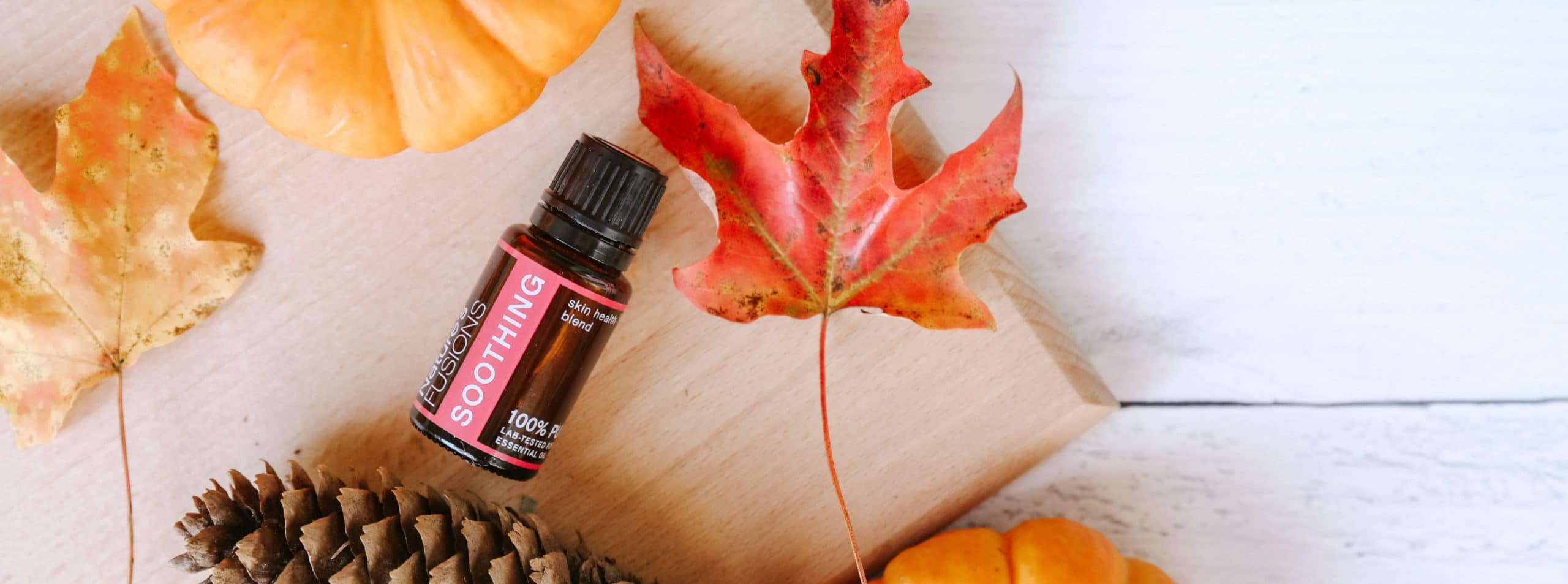 bottle of Soothing blend with fall decorations