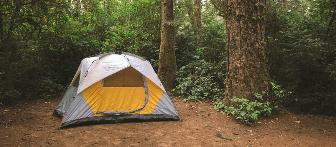 tent set up in a woodland clearing