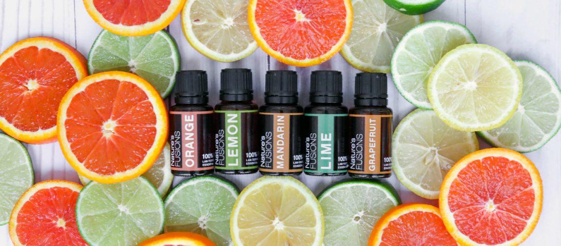 citrus slices surrounding oil bottles