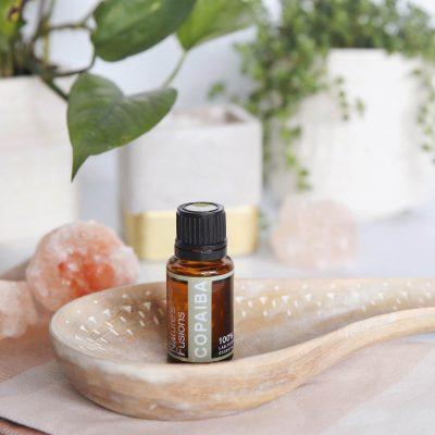 Copaiba on bathroom counter with salt rocks