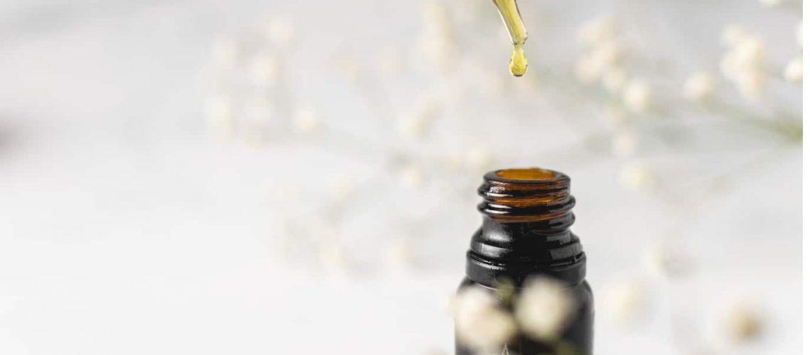 oil dropper bottle on simple background